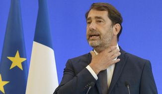 French Interior Minister Christophe Castaner, gestures during a media conference in Paris, Monday, June 8, 2020. French Interior Minister Christophe Castaner said police will no longer conduct chokeholds that have been blamed for multiple cases of asphyxiation and have come under renewed criticism after George Floyd's death in the United States. (Isa Harsin/Pool Photo via AP)
