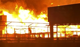 In a photo provided by the Phoenix Fire Department, a fire burns at a construction site near downtown Phoenix on Sunday, June 7, 2020. The building on fire was under construction, according to a tweet from the Phoenix Fire Department. The cause of the fire wasn't immediately known and it was unclear whether anyone was injured. (Capt. Frank Keller/Phoenix Fire Department via AP)