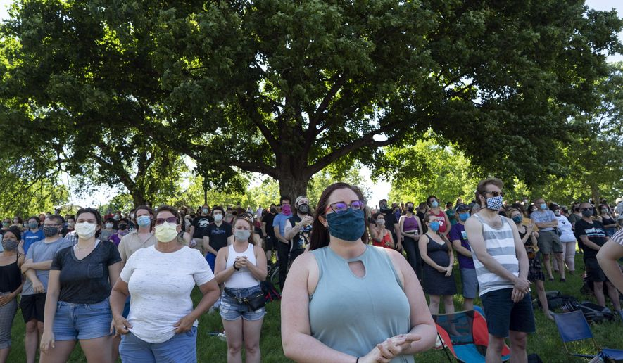"""Community members at gather at """"The Path Forward"""" meeting, a meeting between city council and community members, at Powderhorn Park, Sunday, June 7, 2020, in Minneapolis. The focus of the meeting was to defund the Minneapolis Police Department. ( Jerry Holt/Star Tribune via AP)  ** FILE **"""