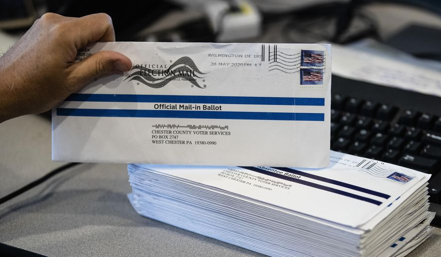 In this May 28, 2020, file photo, mail-in ballots are processed at the Chester County Voter Services office in West Chester, Pa., prior to the primary election. Democrats are mounting a new effort to push back against a well-funded Republican campaign that seeks to undermine public confidence in mail-in-voting. (AP Photo/Matt Rourke, File)