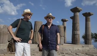 """This image released by IFC Films shows Rob Brydon, right, and Steve Coogan in a scene from """"The Trip to Greece."""" (Andy Hall/IFC Films via AP)"""