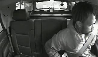 This image taken from May, 23, 2020, video shows Maurice Gordon, of Poughkeepsie, N.Y., as he unbuckles his seatbelt before exiting a New Jersey State Trooper's vehicle in Bass River, N.J. New Jersey's top law enforcement official has finished an initial investigation into the fatal shooting by a state trooper of Gordon after a traffic stop and is expected to release video from the incident on Monday, June 8, 2020, according to the attorney general's office. (New Jersey Attorney General's Office via AP)