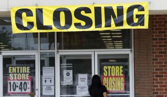 A woman walks into a closing Gordmans store, Thursday, May 28, 2020, in St. Charles, Mo. Stage Stores, which owns Gordmans, is closing all its stores and has filed for Chapter 11 bankruptcy. (AP Photo/Jeff Roberson)