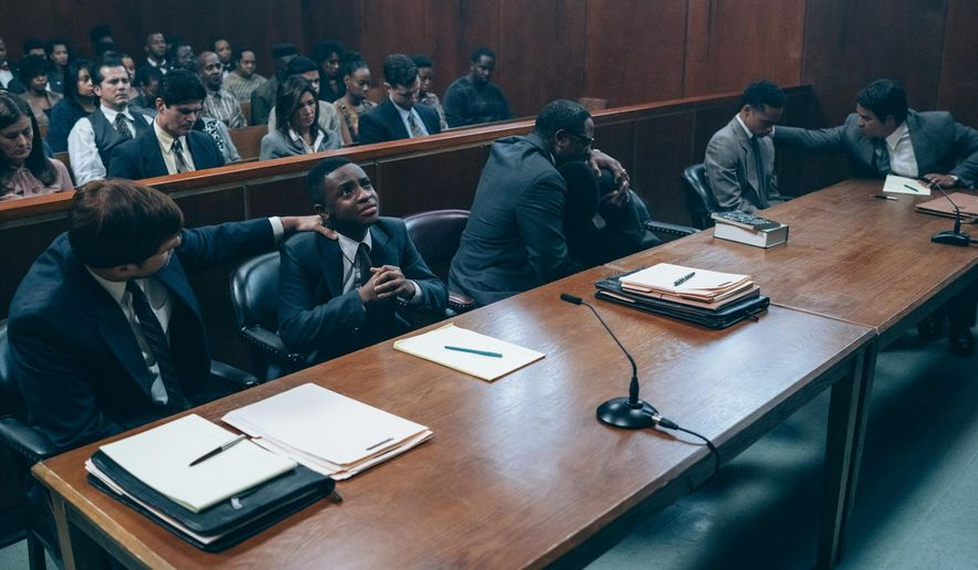 "This image released by Netflix shows a scene from ""When They See Us."" The four-part Netflix series explores the true story of the Central Park Five, five black and Latino teenagers who were coerced into confessing to a rape they didn't commit in 1989. (Atsushi Nishijima/Netflix via AP)"