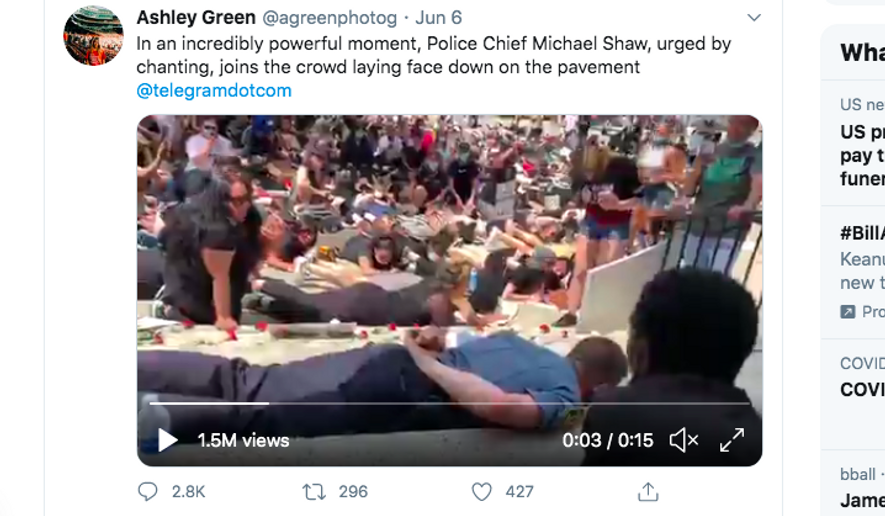 Twitter screenshot of Webster, Mass., Police Chief Michael Shaw in the ground amid protests.