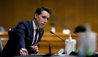 Sen. Josh Hawley, R-Mo., speaks during a Senate Judiciary Committee hearing on Capitol Hill in Washington, Tuesday, June 9, 2020, to examine COVID-19 fraud, focusing on law enforcement's response to those exploiting the pandemic. (AP Photo/Andrew Harnik, Pool)