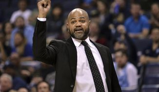 FILE - In this March 23, 2019, file photo, Memphis Grizzlies head coach J.B. Bickerstaff calls to players in the first half of an NBA basketball game against the Minnesota Timberwolves, in Memphis, Tenn. The Cleveland Cavaliers weren't invited inside the NBA's Disney World summer bubble. They never want to have the door close on them again. (AP Photo/Brandon Dill, File)