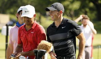 Rory McIlroy, right, smiles during practice for the Charles Schwab Challenge golf tournament at the Colonial Country Club in Fort Worth, Texas, Tuesday, June 9, 2020. The Challenge is the first PGA tour event since the COVID-19 pandemic began. (Tom Fox/The Dallas Morning News via AP)  **FILE**