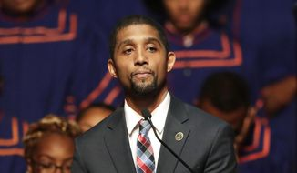 In this Oct. 23, 2019, file photo, then-Baltimore Council President Brandon Scott speaks during a viewing service for the late U.S. Rep. Elijah Cummings at Morgan State University in Baltimore. Now mayor of Baltimore, Mr. Scott announced on April 30, 2021, that he was lifting the city's outdoor mask mandate. (AP Photo/Julio Cortez, File)  **FILE**