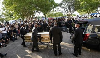 The casket of George Floyd is removed after a public visitation for Floyd at the Fountain of Praise church, Monday, June 8, 2020, in Houston. (AP Photo/David J. Phillip, Pool)