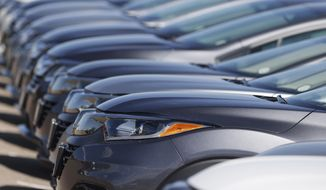 This file photo dated Sunday, June 7, 2020, shows a long row of unsold cars at a Honda dealership in Highlands Ranch, USA. Japanese carmaker Honda says in a statement released Tuesday, June 9, 2020, it has been hit by a cyberattack on the Honda network, although the company says there was no information breach. (AP Photo/David Zalubowski, file)