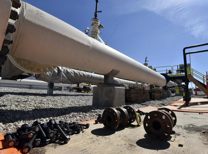 FILE - In this June 8, 2017, file photo, fresh nuts, bolts and fittings are ready to be added to the east leg of the Enbridge Line 5 pipeline near St. Ignace, Mich., as Enbridge prepares to test the east and west sides of the Line 5 pipeline under the Straits of Mackinac in Mackinaw City, Mich. Enbridge Inc. has produced legally acceptable plans for dealing with a potential spill from oil pipelines that cross a Michigan channel linking two of the Great Lakes, according to a panel of the 6th U.S. Circuit Court of Appeals in a court ruling June 5, 2020. (Dale G. Young/Detroit News via AP, File)