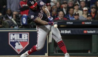 FILE - In this Oct. 30, 2019, file photo, Washington Nationals' Howie Kendrick hits a two-run home run during the seventh inning of Game 7 of the baseball World Series against the Houston Astros in Houston. Major League Baseball has proposed expanding the playoff field from 10 teams to as many as 16 for this year and next season. Other major sports are accustomed to more teams in the postseason. (AP Photo/David J. Phillip, File)