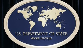 This Aug. 10, 2006, file photo shows the sign used as the backdrop for press briefings at the U.S. Department of State in Washington.  (AP Photo/Charles Dharapak. File)