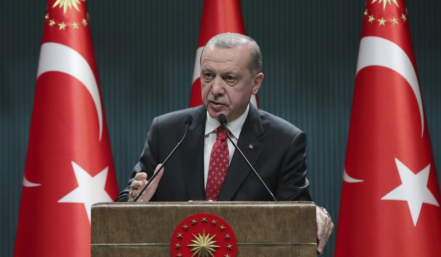 Turkish President Recep Tayyip Erdogan speaks after a cabinet meeting, in Ankara, Turkey, Tuesday, June 9, 2020. Erdogan has revealed new plans to ease restrictions in place to curb the spread of the coronavirus, including the July 1 reopening of theaters, cinemas and other entertainment centers. (Presidential Press Service via AP, Pool)
