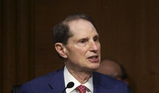 "Sen. Ron Wyden, D-Ore., speaks during a Senate Finance Committee hearing on ""COVID-19/Unemployment Insurance"" on Capitol Hill in Washington on Tuesday, June 9, 2020. (Leah Millis/Pool via AP) ** FILE **"
