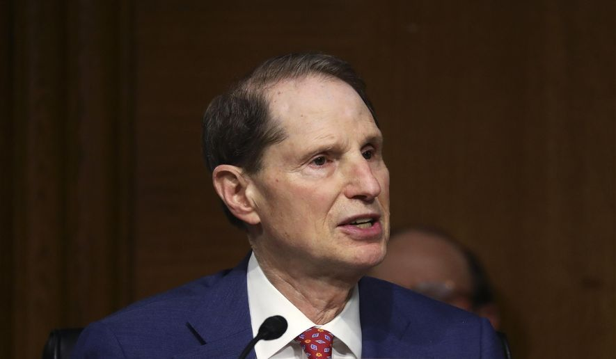 """Sen. Ron Wyden, D-Ore., speaks during a Senate Finance Committee hearing on """"COVID-19/Unemployment Insurance"""" on Capitol Hill in Washington on Tuesday, June 9, 2020. (Leah Millis/Pool via AP) ** FILE **"""