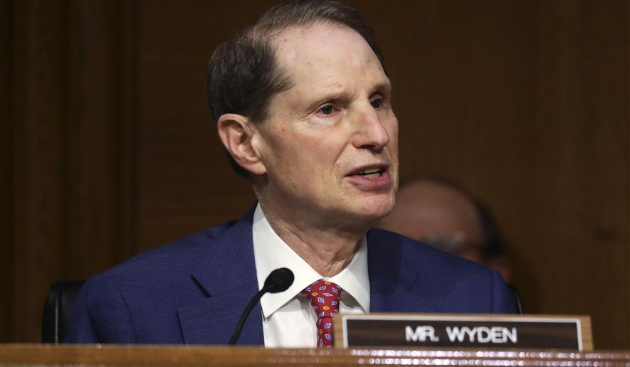 "Sen. Ron Wyden, D-Ore., speaks during a Senate Finance Committee hearing on ""COVID-19/Unemployment Insurance"" on Capitol Hill in Washington on Tuesday, June 9, 2020. (Leah Millis/Pool via AP)"