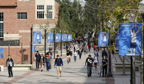 Students walk on the University of California, Los Angeles campus. (AP File Photo/Damian Dovarganes, File)