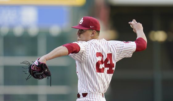 In this Feb. 28, 2020, photo, Oklahoma's Cade Cavalli throws a pitch during an NCAA baseball game against Arkansas in Houston. The Washington Nationals selected Cavalli in the baseball draft Wednesday, June 10, 2020. (AP Photo/Matt Patterson)  **FILE**