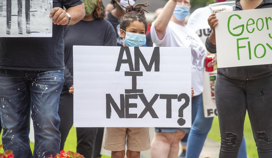 Protesters rally in solidarity with those in Minnesota over the killing of George Floyd by police, in Lafayette, La. Sunday, May 31, 2020.  (Scott Clause/The Daily Advertiser via AP)