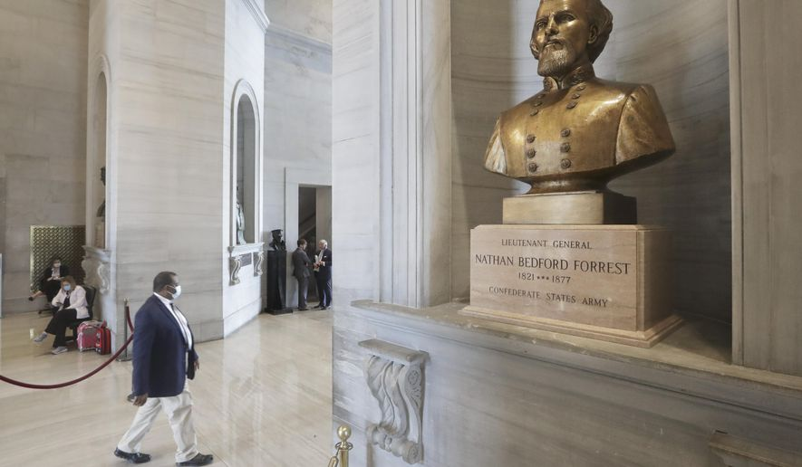 """A bust of Nathan Bedford Forrest is displayed in the Tennessee State Capitol Tuesday, June 9, 2020, in Nashville, Tenn. Tennessee lawmakers remain torn on whether to support a proposal for the removal of a contentious bust of the former Confederate general and early leader of the Ku Klux Klan. If approved by the GOP-controlled Legislature, the measure encourages the bust of Forrest be removed from the Tennessee Capitol and instead be replaced with an """"appropriate tribute to a deserving Tennessean."""" (AP Photo/Mark Humphrey)"""