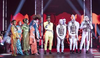 "This image released by HBO Max shows Dashaun Wesley, center, with contestants on the series ""Legendary.""  The series lifts the veil off the underground world of ballroom culture, in which historically black and Latino LGBT youths compete in elaborate performances on a runway. (HBO Max via AP)"