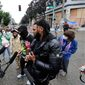 "Hip-hop artist and activist Raz Simone (right) has emerged as a leading figure of Black Lives Matter in the self-declared ""Capitol Hll Autonomous Zone"" in Seattle. (Associated Press)"