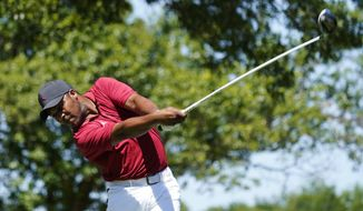 Harold Varner III tees off on the 14th hole during the first round of the Charles Schwab Challenge golf tournament at the Colonial Country Club in Fort Worth, Texas, Thursday, June 11, 2020. (AP Photo/David J. Phillip)