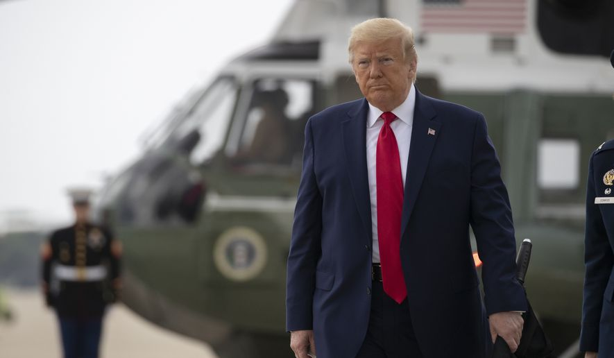 President Donald Trump walks to board Air Force One, Thursday, June 11, 2020, at Andrews Air Force Base, Md. Trump is en route to Dallas. (AP Photo/Alex Brandon)
