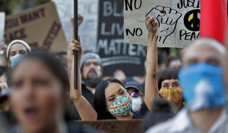Protesters rally outside the Mesa Police Department building Tuesday, June 9, 2020, in Mesa, Ariz., demanding police reform. (AP Photo/Matt York)