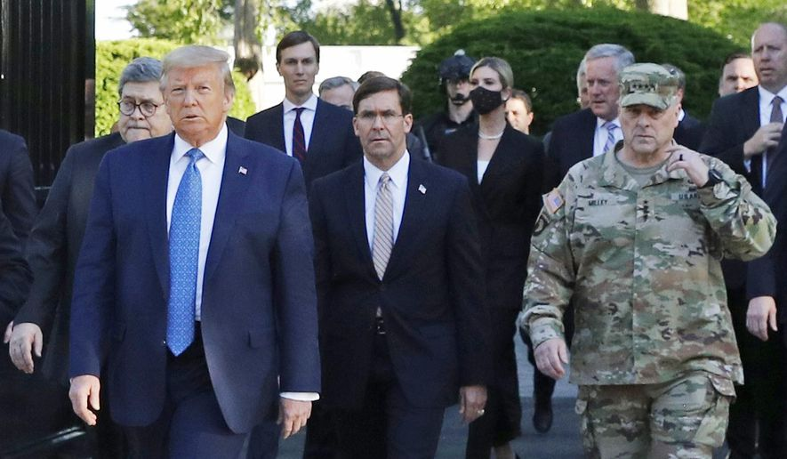 """In this June 1, 2020, file photo, President Donald Trump departs the White House to visit outside St. John's Episcopal Church, in Washington. Part of the church was set on fire during protests on Sunday night. Walking behind Trump from left are, Attorney General William Barr, Secretary of Defense Mark T. Esper and Gen. Mark Milley, chairman of the Joint Chiefs of Staff. Milley says his presence """"created a perception of the military involved in domestic politics."""" He called it """"a mistake"""" that he has learned from. (AP Photo/Patrick Semansky)"""