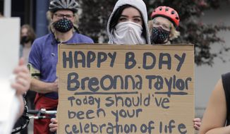 A person holds a sign Friday, June 5, 2020, that mentions Breonna Taylor, a black woman killed by Kentucky police on March 13, during a protest Friday, June 5, 2020, in Tacoma, Wash., against police brutality. Taylor would have turned 27-years-old on Friday. (AP Photo/Ted S. Warren)