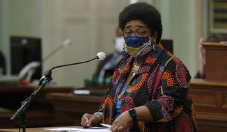 Assemblywoman Shirley Weber, D-San Diego, wears a face mask as she calls on lawmakers to create a task force to study and develop reparation proposals for African Americans, during the Assembly session in Sacramento, Calif., Thursday, June 11, 2020. The Assembly approved the bill that now goes to the Senate. (AP Photo/Rich Pedroncelli)