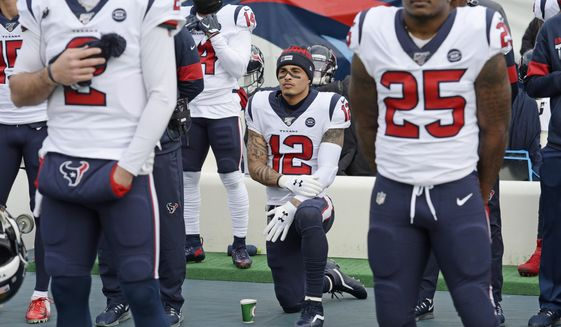 In this Dec. 15, 2019, file photo, Houston Texans wide receiver Kenny Stills (12) kneels during the national anthem before an NFL football game between the Texans and the Tennessee Titans in Nashville, Tenn. NFL players who want to kneel during the national anthem to protest police brutality and racism have far more support than Colin Kaepernick did four years ago. (AP Photo/Mark Zaleski, File)