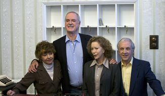 """In this file photo dated Wednesday, May 6, 2009, the cast of Fawlty Towers from left, Prunella Scales, John Cleese, Connie Booth and Andrew Sachs reunite to celebrate the 30th anniversary of the TV show and mark a special program """"Fawlty Towers: Re-opened"""" at The Naval and Military Club, London. One of the most memorable episodes of one of the most popular British sitcoms of all-time, Fawlty Towers, has been withdrawn from a streaming service because of numerous racial slurs. (AP Photo/ Edmond Terakopian, FILE)"""