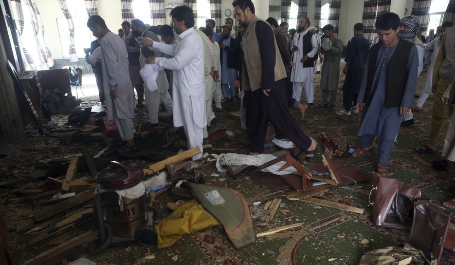 Afghans inspect the inside of a mosque following a bombing, in Kabul, Afghanistan, Friday, June 12, 2020. (AP Photo/Rahmat Gul)