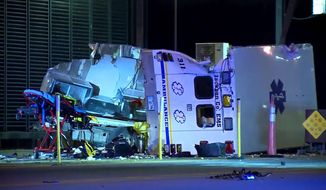 This image taken from video provided by KOCO-5 shows a Jackson County Emergency Medical Services ambulance that was traveling from the Altus, Okla., area to Oklahoma City, after it crashed along Interstate 44 into a toll booth near Newcastle shortly before 3 a.m. Friday June 12, 2020. A patient and two paramedics who were in the ambulance were flown by helicopter to an Oklahoma City hospital in critical condition. The toll booth worker was taken by another ambulance to a hospital. (Jessica Brogdon/KOCO-5 via AP)