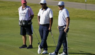 From right, Zac Blair, Harold Varner III and caddie Rick Wynn observe a moment of silence to pay their respects to the memory of George Floyd on the 16th hole during the second round of the Charles Schwab Challenge golf tournament at the Colonial Country Club in Fort Worth, Texas, Friday, June 12, 2020. (AP Photo/David J. Phillip)