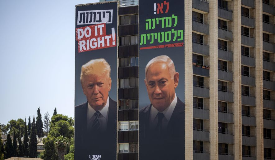"""Billboards shows Israeli Prime Minister Benjamin Netanyahu, right, and U.S President Donald Trump in Jerusalem, placed by Yesha Council, an organization of municipal councils of Jewish settlements in the West Bank, Wednesday, June 10, 2020. Hebrew on billboard reads """"No for Palestinian state"""" and """"Sovereignty Do it right."""" (AP Photo/Oded Balilty)"""