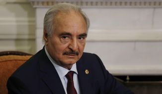 In this Jan. 17, 2020, file, photo, Libyan Gen. Khalifa Hifter joins a meeting with the Greek Foreign Minister Nikos Dendias in Athens.(AP Photo/Thanassis Stavrakis, File)