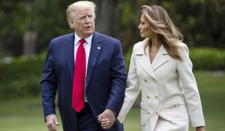 In this May 25, 2020, photo, President Donald Trump, accompanied by first lady Melania Trump, walks as they return on Marine One on the South Lawn of the White House in Washington, after returning from Fort McHenry National Monument and Historic Shrine, in Baltimore, for a Memorial Day ceremony. (AP Photo/Alex Brandon) **FILE**