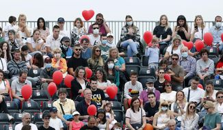 Fans watch a tennis doubles match between Serbia's Novak Djokovic and Jelena Jankovic and Serbia's Nenad Zimonjic and Olga Danilovic during the Adria Tour charity tournament, in Belgrade, Serbia, Friday, June 12, 2020. Serbian tennis player Novak Djokovic set up a series of tennis tournaments in the Balkan region while the sport is suspended amid the coronavirus pandemic. (AP Photo/Darko Vojinovic)