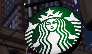 FILE - This June 26, 2019, file photo shows a Starbucks sign outside a Starbucks coffee shop in downtown Pittsburgh. Starbucks announced Friday, June 12, 2020, that the company is creating its own Black Lives Matter shirt for employees to wear if they choose. The move comes after the coffee chain reportedly banned employees from wearing Black Lives Matter gear. (AP Photo/Gene J. Puskar, File)