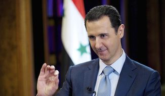 In this Feb. 10, 2015, file photo released by the Syrian official news agency SANA, Syrian President Bashar Assad gestures during an interview in Damascus, Syria. (SANA via AP, File)