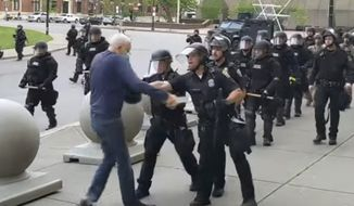 This June 4, 2020, file image from video provided by WBFO, a Buffalo police officer appears to shove a man who walked up to police in Buffalo, N.Y. (Mike Desmond/WBFO via AP)