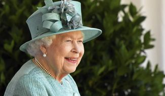 Britain's Queen Elizabeth II reacts as she looks out during a ceremony to mark her official birthday at Windsor Castle in Windsor, England, Saturday June 13, 2020. Queen Elizabeth II's birthday is being marked with a smaller ceremony than usual this year, as the annual Trooping the Color parade is canceled amid the coronavirus pandemic. The Queen celebrates her 94th birthday this year. (Toby Melville/Pool via AP)