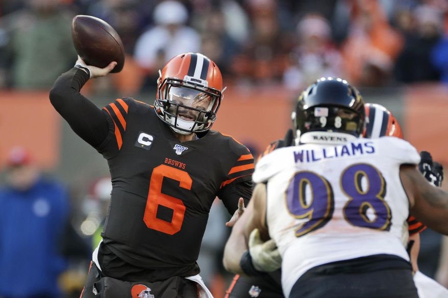 FILE - In this Sunday, Dec. 22, 2019 file photo, Cleveland Browns quarterback Baker Mayfield (6) passes against the Baltimore Ravens during the second half of an NFL football game in Cleveland. Cleveland Browns quarterback Baker Mayfield plans to kneel during the national anthem this upcoming season to support protests of social injustice, police brutality and racism, Saturday, June 13, 2020. (AP Photo/Ron Schwane, File)