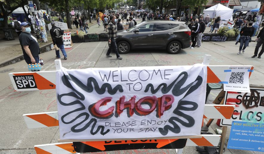 "A sign reads ""Welcome to CHOP,"" Sunday, June 14, 2020, inside what has been named the Capitol Hill Occupied Protest zone in Seattle. Protesters calling for police reform and other demands have taken over several blocks near downtown Seattle after officers withdrew from a police station in the area following violent confrontations. The CHOP name is a change from CHAZ (Capitol Hill Autonomous Zone) that was used earlier in the week. (AP Photo/Ted S. Warren)"