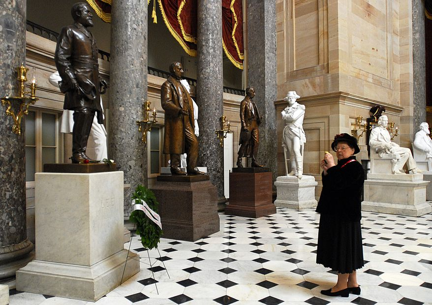 Vicki Heilig, national committee chairman of the Daughters of the Confederacy and president of the Robert E. Lee chapter 644, pauses after taking a picture of Lee's statue in Statuary Hall in the Capitol. Ms. Heilig was one of the daughters who placed a wreath at Lee's statue on Friday, Jan. 19, 2007 in honor of his birthday. (Barbara L. Salisbury / The Washington Times)